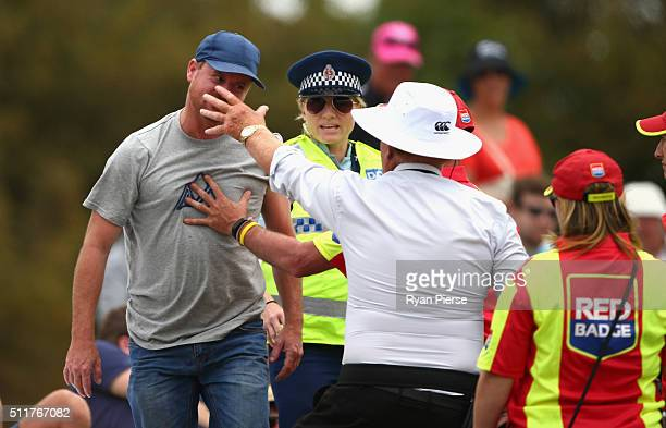 Security detain a spectator during day four of the Test match between New Zealand and Australia at Hagley Oval on February 23 2016 in Christchurch...