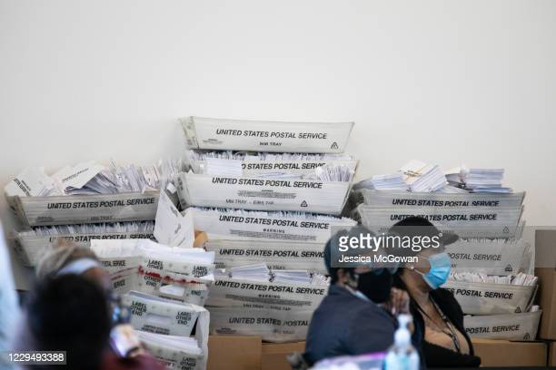 Security envelopes for absentee ballots sit in stacked boxes as Fulton county workers continue to count absentee ballots at State Farm Arena on...