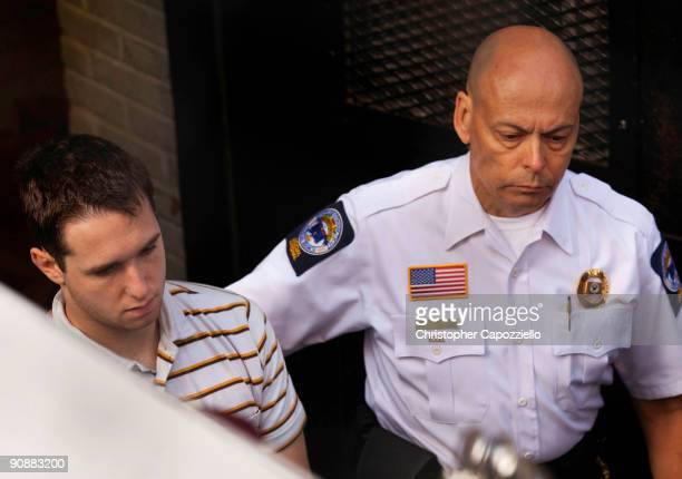 Security escorts Raymond Clark III for arraignment at the New Haven Superior Court after earlier this morning when he was arrested at a Super 8 Motel...