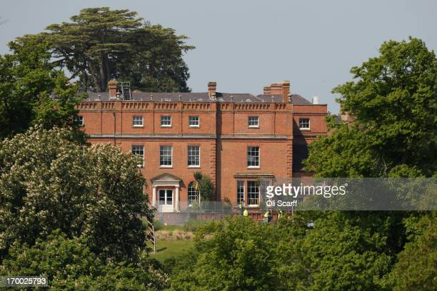 Security fence surrounds The Grove hotel which is hosting the annual Bilderberg conference on June 6, 2013 in Watford, England. The traditionally...
