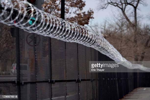 Security fencing runs down a street near the U.S. Capitol building on January 17, 2021 in Washington, DC. After last week's riots at the U.S. Capitol...
