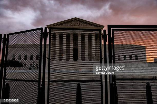 Security fencing surrounds the U.S. Supreme Court which is adjacent to the U.S. Capitol on the morning of January 17, 2021 in Washington, DC. After...