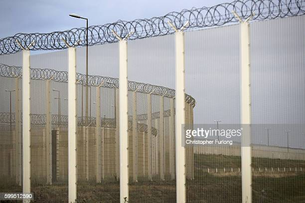 Security fencing to prevent migrants surrounds the Port of Calais on September 4 2016 in Calais France Local people and business owners are taking...