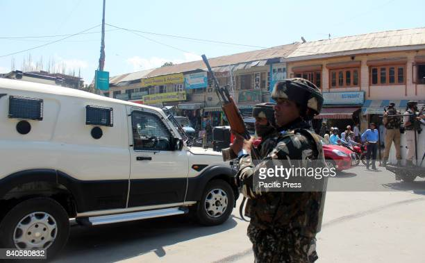 A security force personal in action after unidentified gunman shot and critically injured a policeman Assistant SubInspector in south Kashmir's...