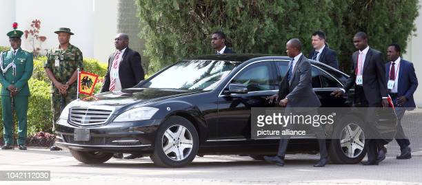 Security forces accompany the car oif German President Joachim Gauck who is to be received with military honors in Abuja Nigeria 11 February 2016...