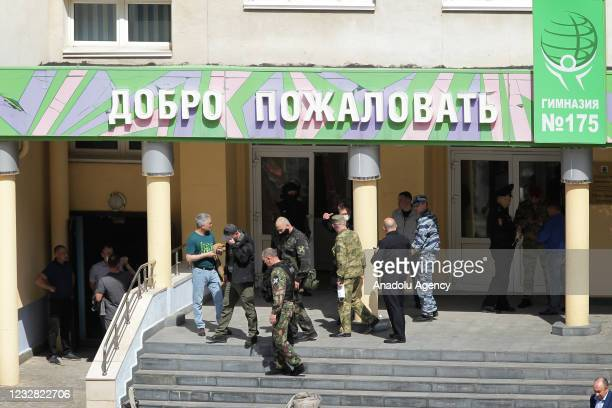 Security forces and investigators arrive at scene after an armed school attack carried out in Tatarstan's capital Kazan in Russia, casualties feared,...