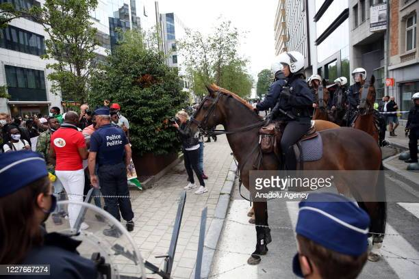 Security forces and mounted police take measures during a protest against French President Emmanuel Macron as he is attending the EU leaders' meeting...