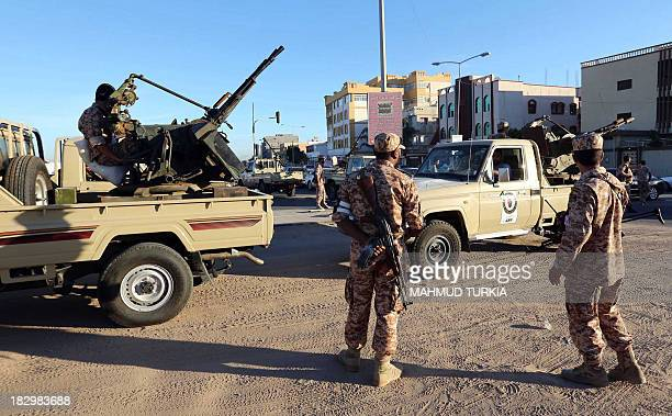 Security forces are positioned outside the court in Tripoli during the pretrial hearing of Libya's exintelligence chief Senussi Baghdadi alMahmudi...