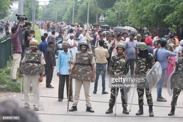 Security forces are seen after Dera followers fire up the vehicles in Panchkula sector 4 after the Dera chief verdict at CBI court on August 25, 2017...