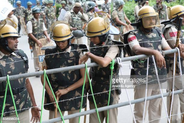 Security forces are seen after Dera followers fire up the vehicles in Panchkula sector 4 after the Dera chief verdict at CBI court on August 25 2017...