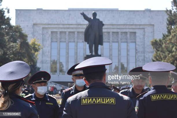 Security forces are seen as protesters gather at Ala-Too Square to protest the results of the parliamentary election in Bishkek, Kyrgyzstan on...