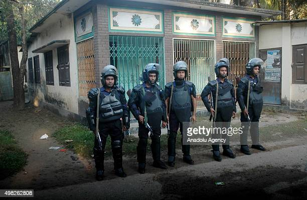 Security forces are seen in front of Jamaat e Islamis Secretary General Ali Ahsan Muhammad Mujahid's ancestral home in Faridpur Bangladesh on...