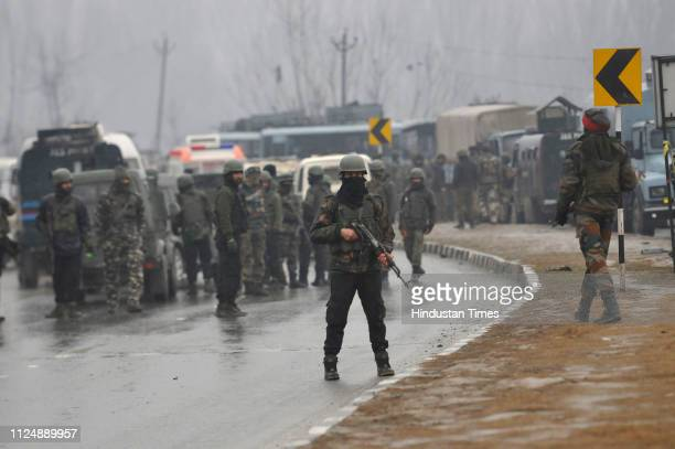 Security forces at the site of the explosion at Lethpora on the JammuSrinagar highway on February 14 2019 in Srinagar India At least 30 CRPF jawans...