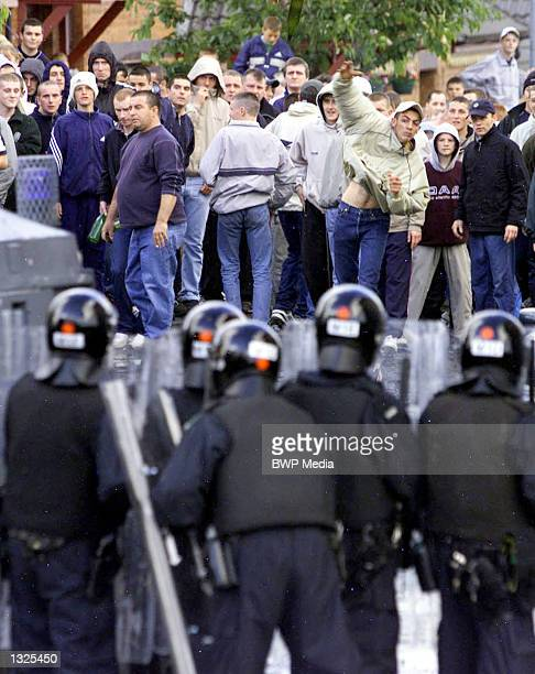 Security forces battled a crowd of about 200 Irish Catholic Nationalists who were protesting Orange Order marches July 12 2001 in north Belfast...