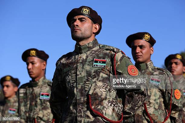 Security forces belonging to the Libyan National Army who completed military education courses parade during their graduation ceremony in Tripoli...