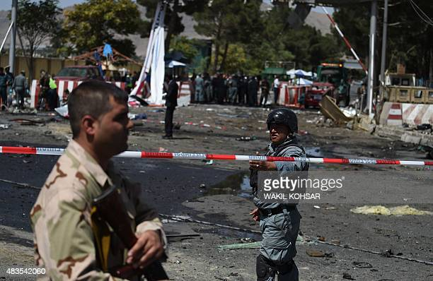security forces block a road near the site of a bomb attack near the entrance to Kabul's international airport in Kabul on August 10 2015 A huge...