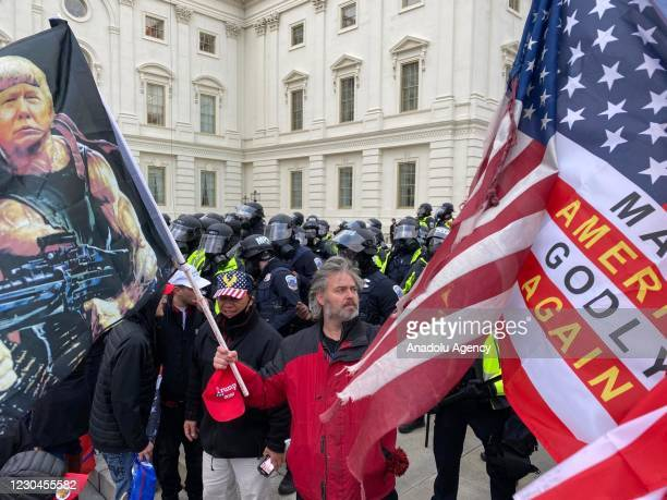 Security forces block the entrance after the US President Donald Trumps supporters breached the US Capitol security in Washington D.C., United States...