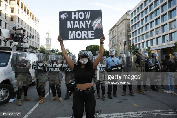 Security forces block the road as protesters gather near Lafayette Park ahead of President Trump's trip to St. John's Church in Washington, United...