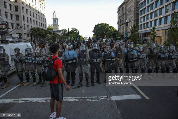 Security forces block the road as protesters gather near Lafayette Park ahead of President Trump's trip to St John's Church in Washington United...