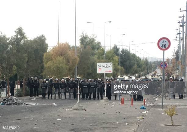 Security forces block the road during the antigovernment protests in Sulaymaniyah in Sulaymaniyah Iraq on December 19 2017