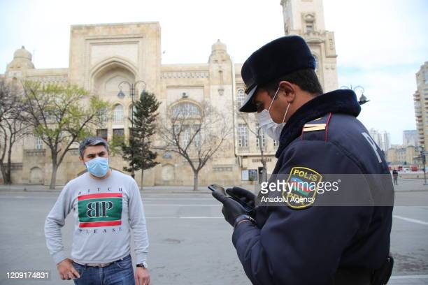 Security forces check and impose fine people going out without SMS messages permission at streets within precautions against coronavirus pandemic in...