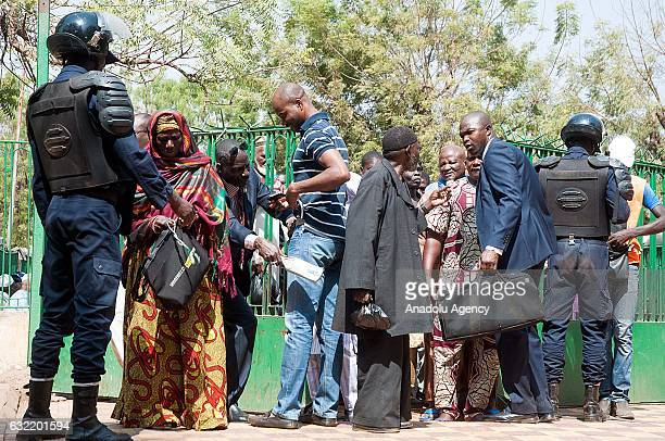 Security forces check people as they attend Friday prayer at Grand Mosque of Bamako in Bamako Mali on January 20 2017