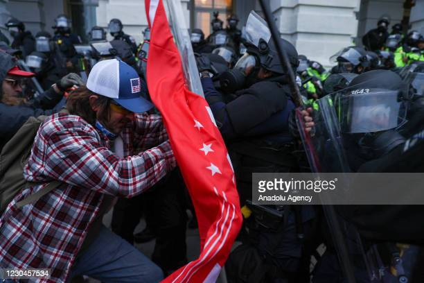Security forces clash with US President Donald Trumps supporters after they breached the US Capitol security in Washington D.C., United States on...