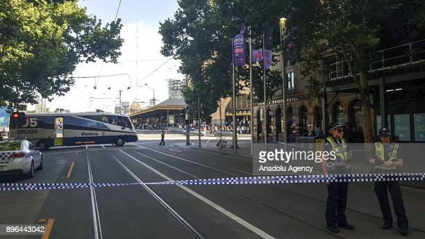 Security forces cordon off the area after a car crashed into crowd at Flinders Street Station in Melbourne Australia on December 20 2017