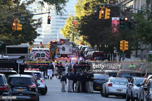 Security forces cordon off the area after a man reportedly drove a pick up truck along a bike lane near the West Side Highway in New York City on...