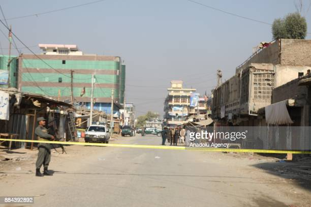 Security forces cordon off the site of bomb attacks in Jalalabad Afghanistan on December 2 2017 Nargarhar governorship spokesperson Ataullah Hogyani...