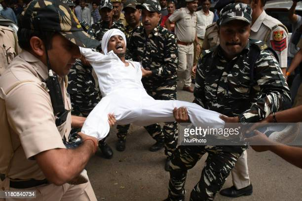 Security forces detain members/protestors of Indian Youth Congress as they protest against the present Prime Minister Narendra Modi led Central...