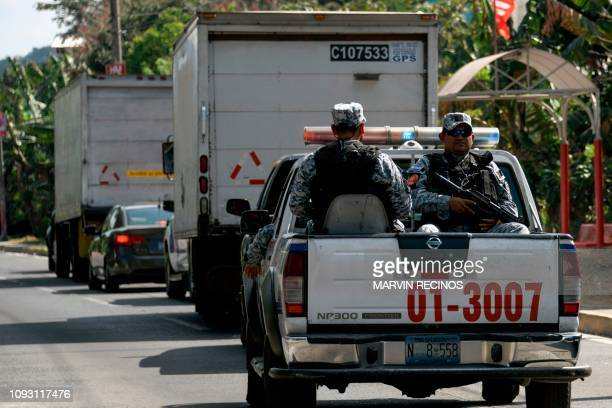 Security forces escort trucks with electoral material on the eve of the first round of the national election in San Salvador on February 2 2019 More...