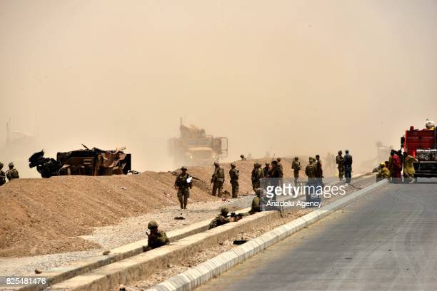 Security forces gather at the area where NATO mission convoy hit by an suicidebomber attack in Kandahar Province of Afghanistan on August 02 2017...