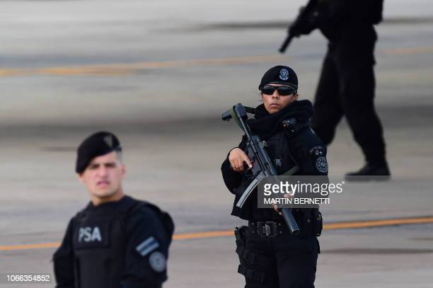 Security forces guard the tarmac during the arrival of Presidents and Heads of State at Ezeiza International airport in Buenos Aires province on...