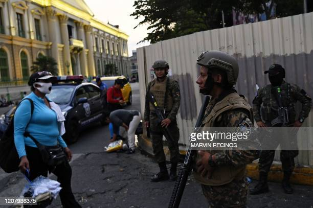 Security forces, including the police and the army, clear people from the historic centre of San Salvador as part of the government's emergency...