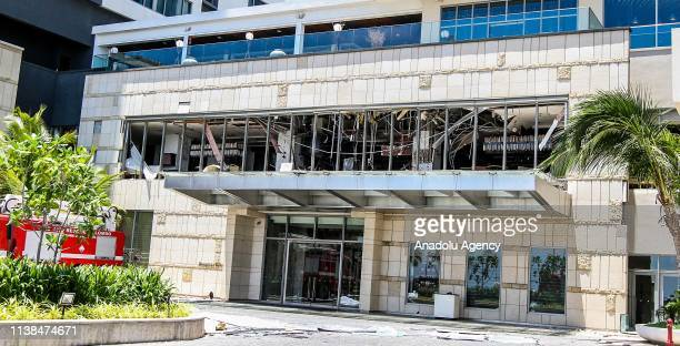 Security forces inspect the scene after a blast targeting Shangri La hotel in Colombo Sri Lanka on April 21 2019 At least 138 people were killed in...