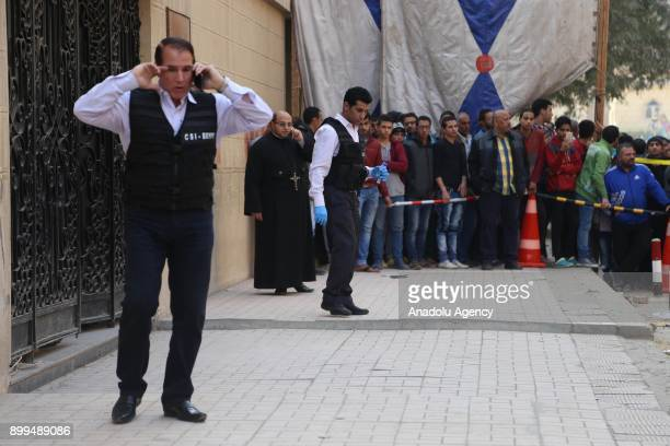 Security forces inspect the scene after an armed attack by unknown assailants to Marminna Church in Cairos southern Helwan district in Cairo Egypt on...