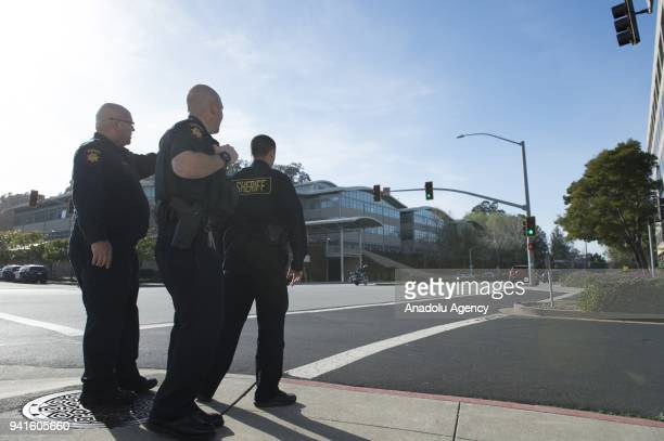 Security forces inspect the scene after they responded to an active shooter at YouTube's California headquarters in San Bruno California United...