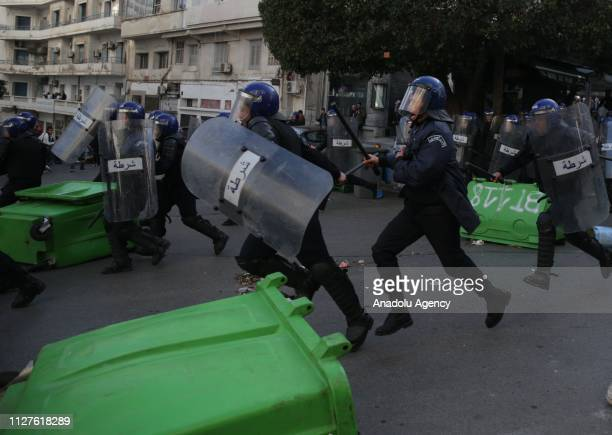 Security forces intervene Algerian university students with tear gas during a protest against candidacy of President Abdelaziz Bouteflika for a fifth...