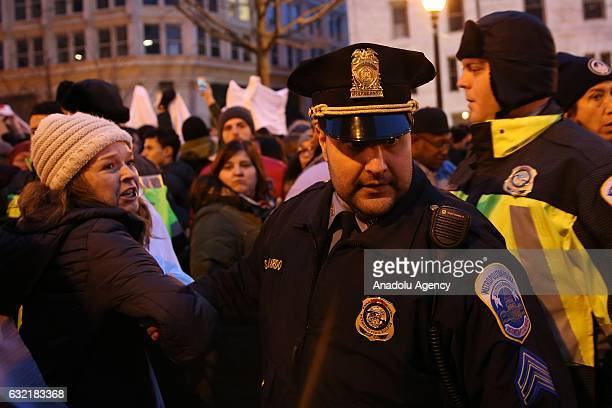 Security forces intervene an antiTrump demonstrator as they try to block entrances on the inauguration day of Donald Trump the 45th President of the...