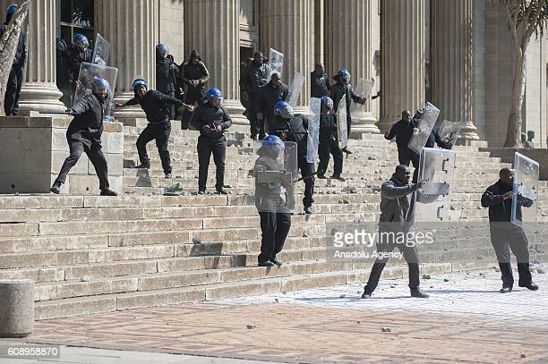 Security forces intervene group of students as they gather to protest after South African Minister of Higher Education and Training Blade Nzimande's...