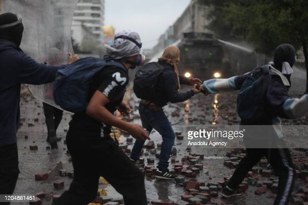 Security forces intervene in protesters during a demonstration against Chilean President Sebastian Pinera's government in Concepcion, Chile on March...