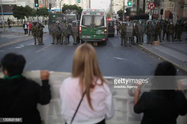 Security forces intervene in protesters during a protest against government at Vina del Mar Music Festival's second day in Vina del Mar, Chile on...
