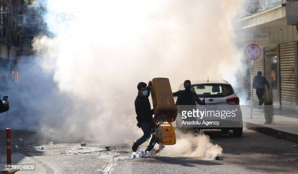 Security forces intervene in protesters with tear gas during a protest against salary delays at Mevlevi street in Sulaymaniyah, Iraq on December 03,...