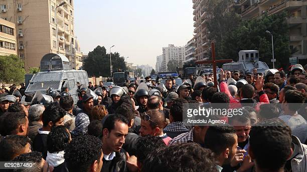 Security forces intervene people during the funeral ceremony for the victims of the explosion at Saint Peter and Saint Paul Coptic Orthodox Church in...