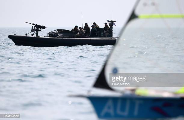 Security forces look on during training at the Weymouth Portland Venue ahead of the London 2012 Olympic Games on July 27 2012 in Weymouth England
