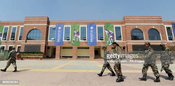 Security forces march past the Dhyan Chand National Stadium the venue for hockey during the 2010 Commonwealth Games in New Delhi India