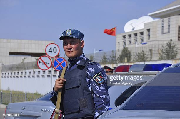 A security forces member stands guard after a bombladen vehicle attack to Chinese Embassy in Kyrgyzstan in Bishkek Kyrgyzstan on August 30 2016
