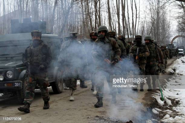 Security forces near the site of encounter at the Ratnipora area of south Kashmir's Pulwama district some 30 kilometers south of Srinagar on February...