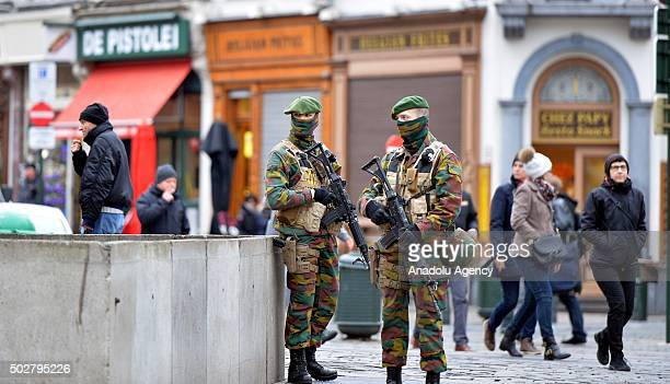 Security forces of Belgium stand guard as two people arrested on suspicion of terrorism in Brussels Belgium on December 29 2015